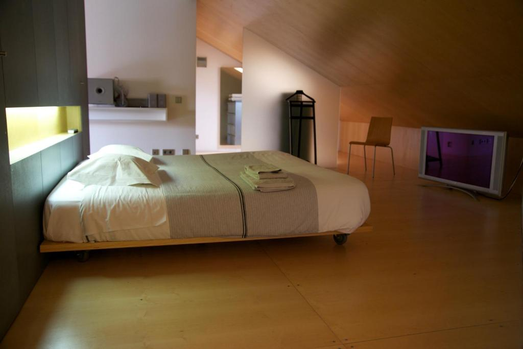 A bed or beds in a room at António Bastos 57