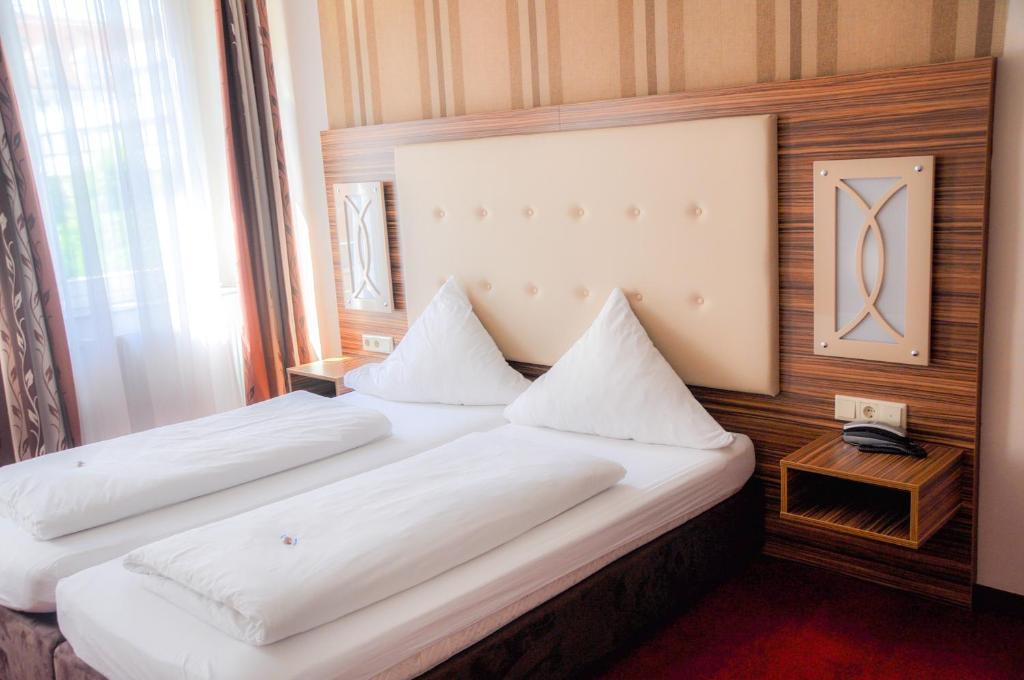 Ein Bett oder Betten in einem Zimmer der Unterkunft Boutique Hotel Villa-Soy