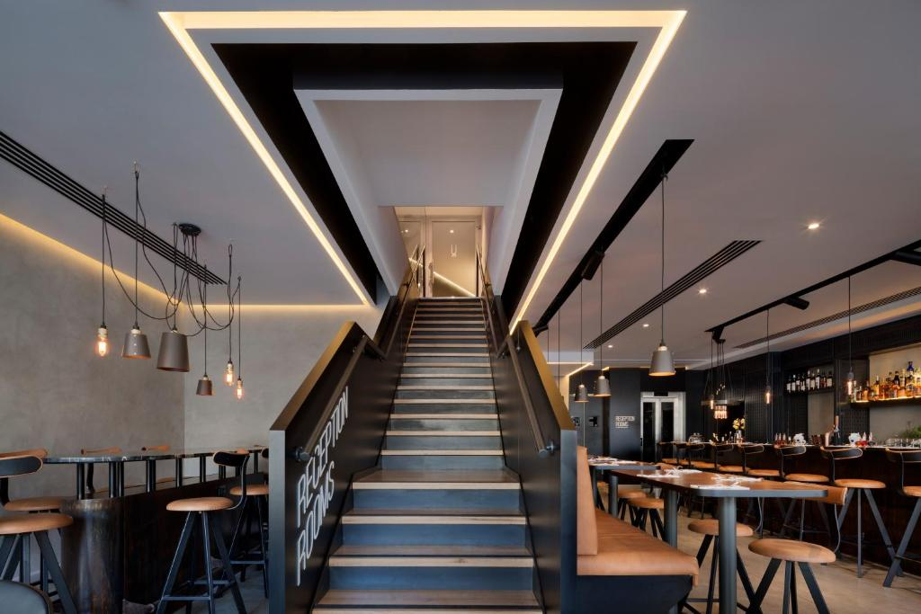 A restaurant or other place to eat at Ultra Tel Aviv Boutique Hotel