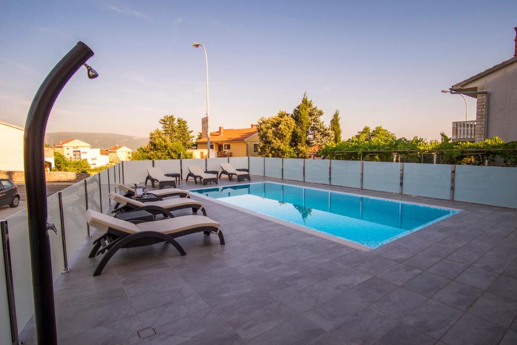 The swimming pool at or near Apartments & Rooms Krk