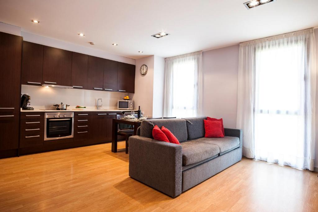 A kitchen or kitchenette at Short Stay Group Camp Nou Serviced Apartments