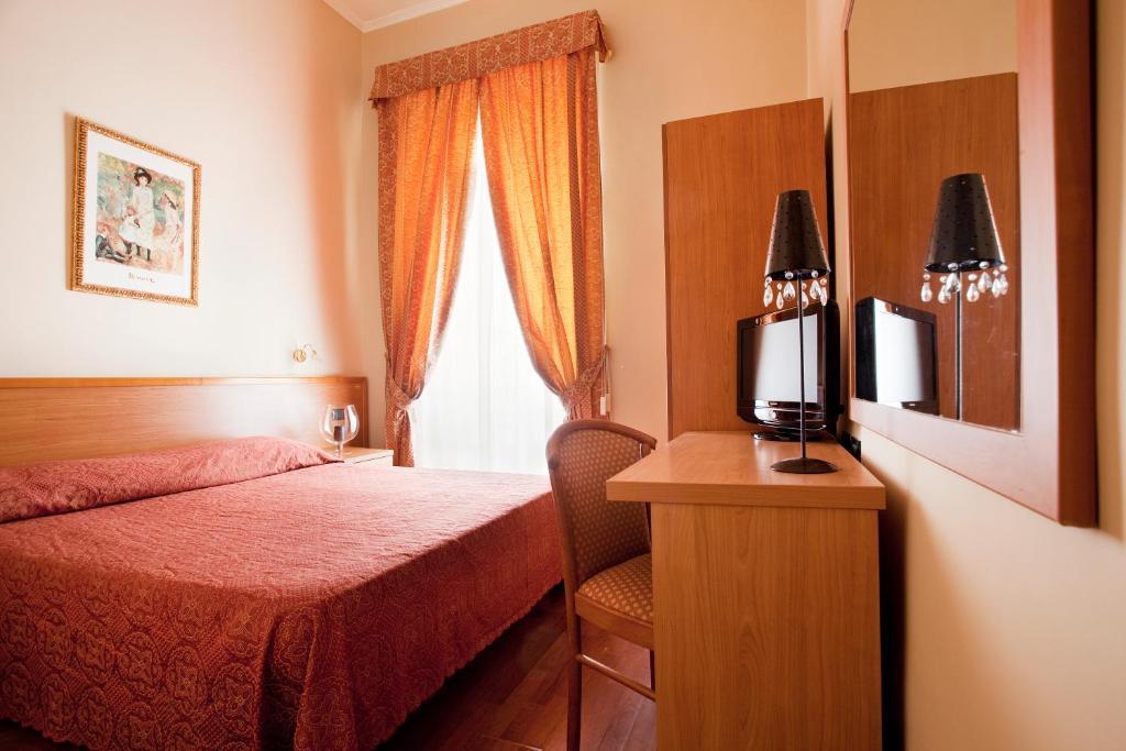 Кровать или кровати в номере Hotel Ducale