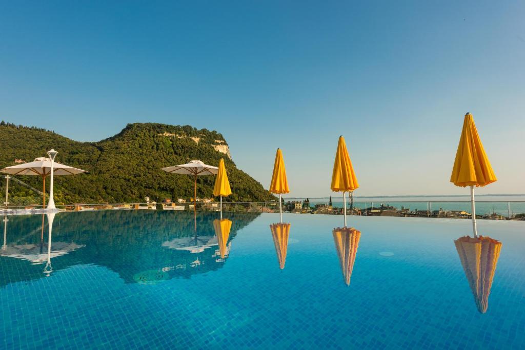 The swimming pool at or near Sky Pool Hotel Sole Garda