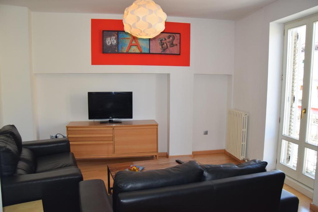 The lounge or bar area at Apartamentos Zaragoza Coso