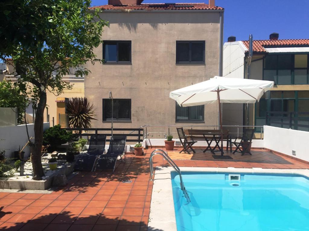 Un patio o zona al aire libre en Hotel O Noso Portosin