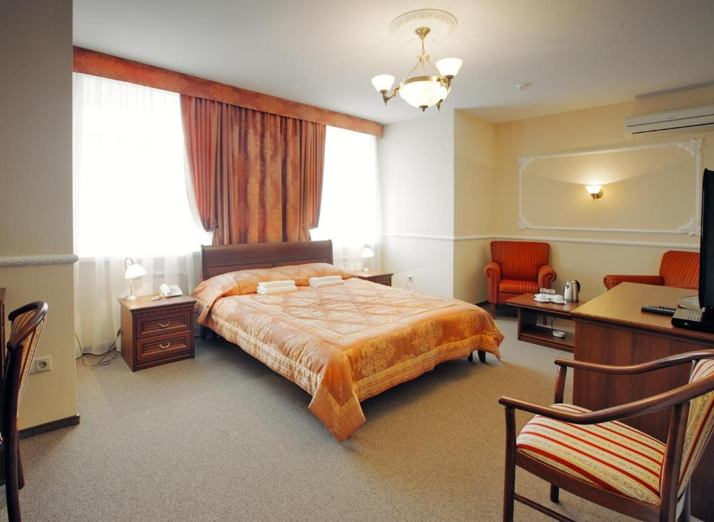 A bed or beds in a room at Nikol Hotel