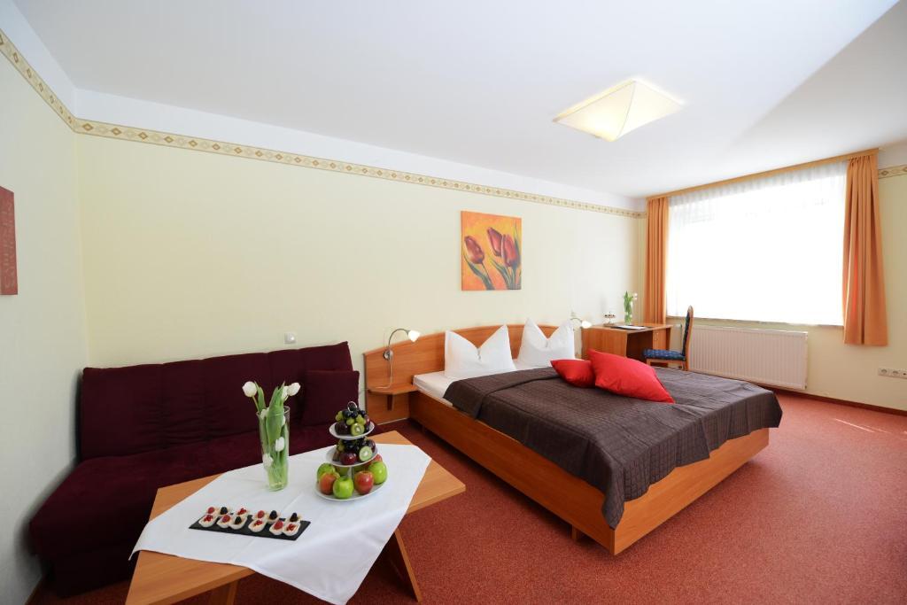 Ein Zimmer in der Unterkunft Hotel Goldenes Herz Schönbrunn