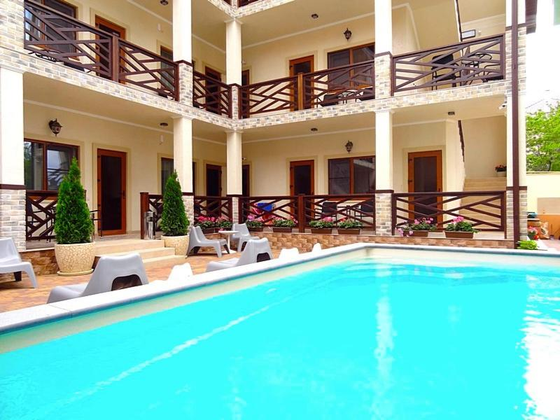 The swimming pool at or near Guest house Raf