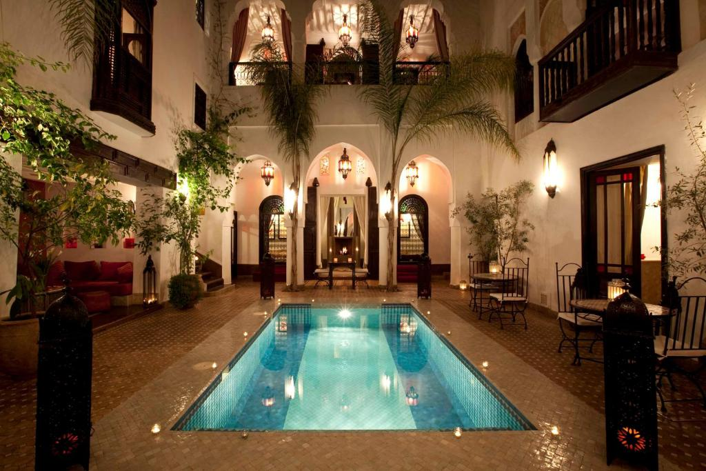 The swimming pool at or near Riad Assouel