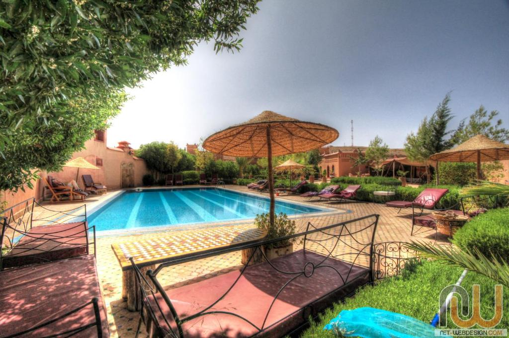 The swimming pool at or near La Perle Du Dades