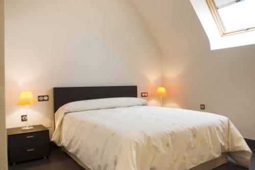 Cama o camas de una habitación en Archybal Apartamentos Turísticos y Suites