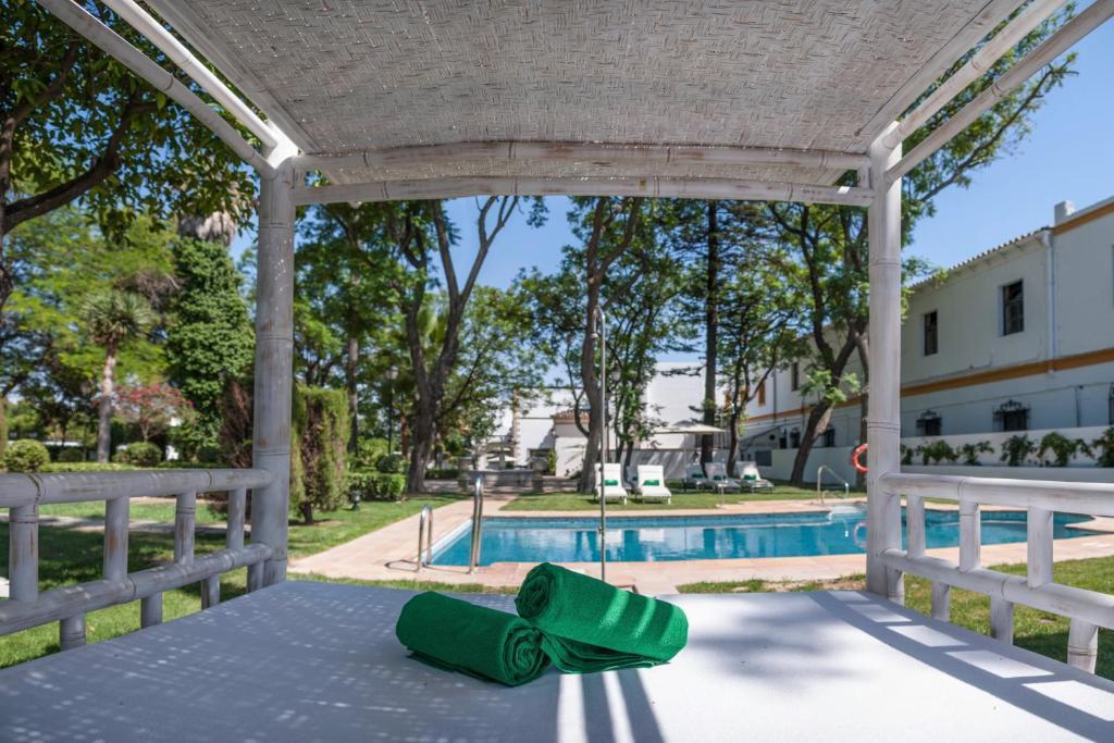 The swimming pool at or near Hotel Duques de Medinaceli