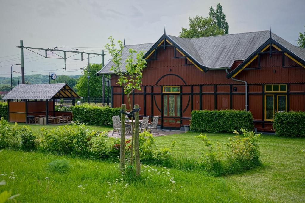 Een tuin van Halte Sint-Gerlach Holiday Home