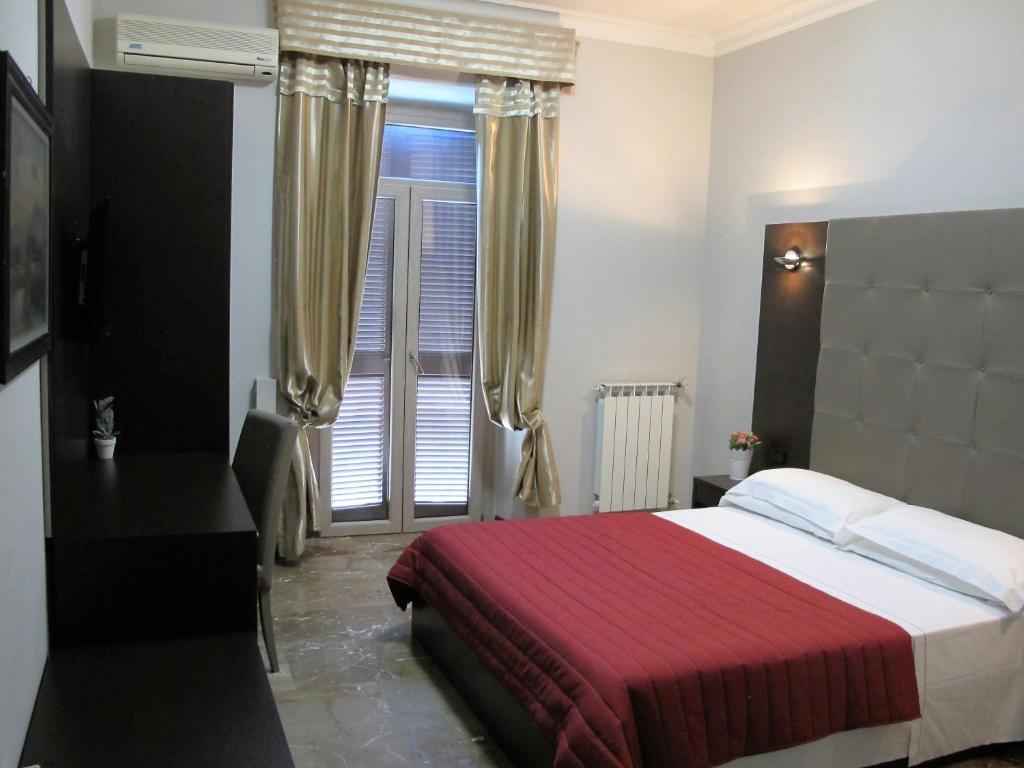 Ein Bett oder Betten in einem Zimmer der Unterkunft Hotel d'Este