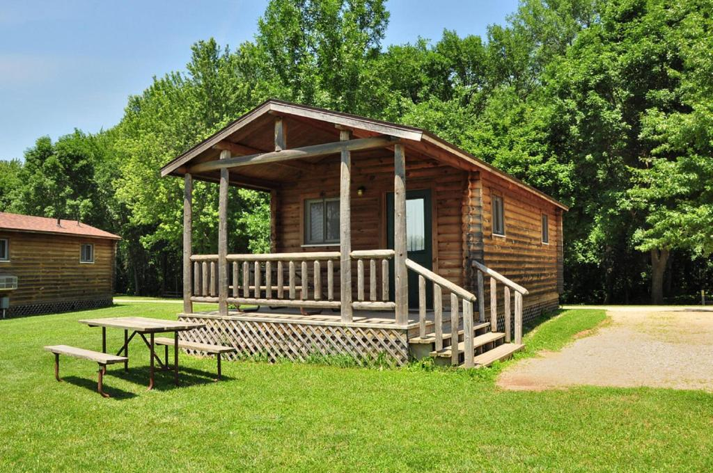 A porch or other outdoor area at Fremont Jellystone Park Cottage 40