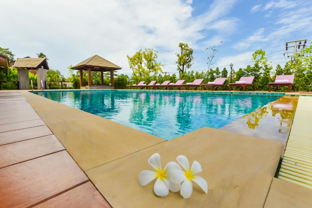 The swimming pool at or near Sirinsamui Boutique Hostel