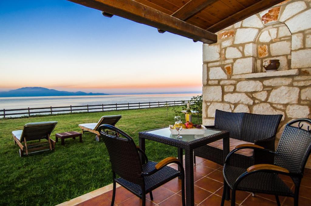A porch or other outdoor area at Kavos Psarou Villas