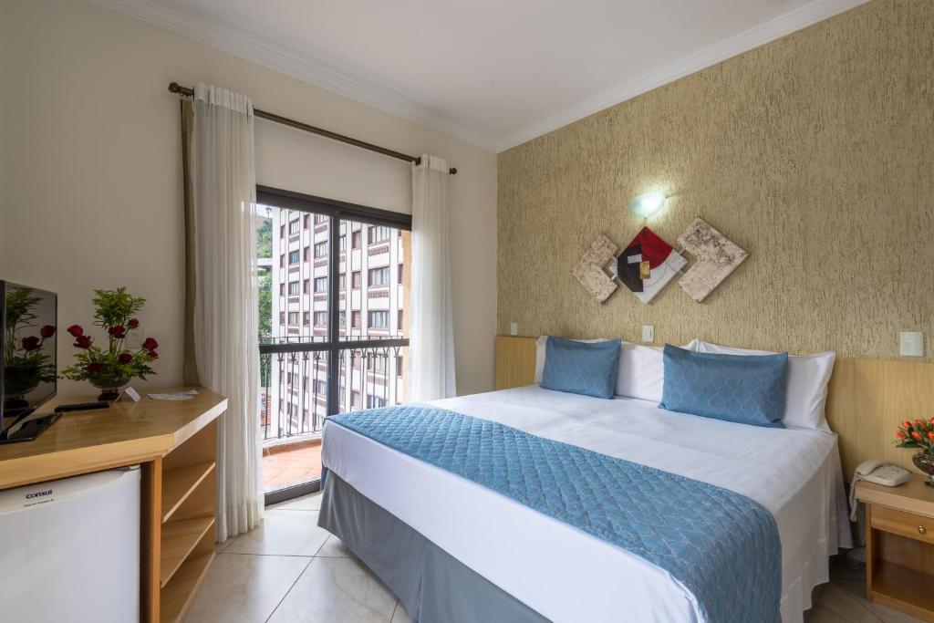 Um quarto em Hotel Guarany