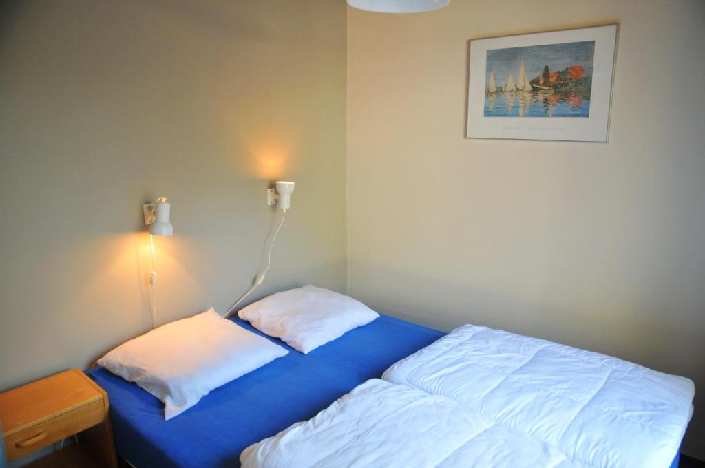 A bed or beds in a room at Village de vacances Waulsort