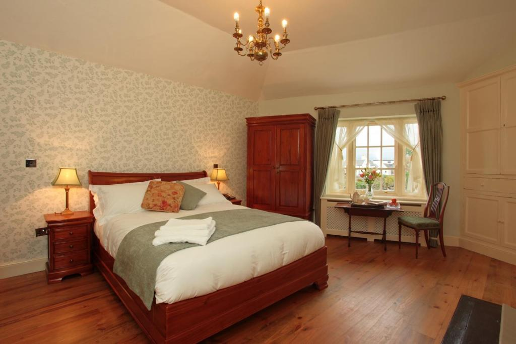 A bed or beds in a room at Corrib House Guest Accommodation