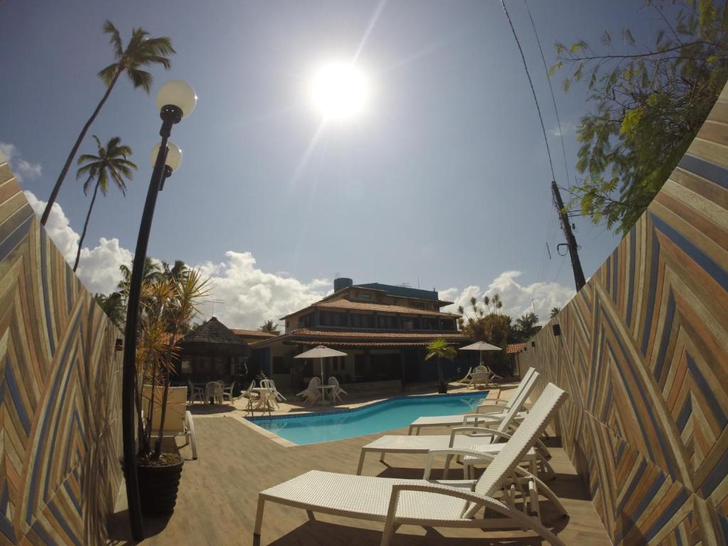 The swimming pool at or near Arandu Pousada