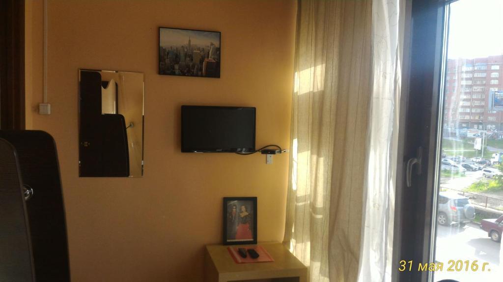 Телевизор и/или развлекательный центр в Мини отель Звездный