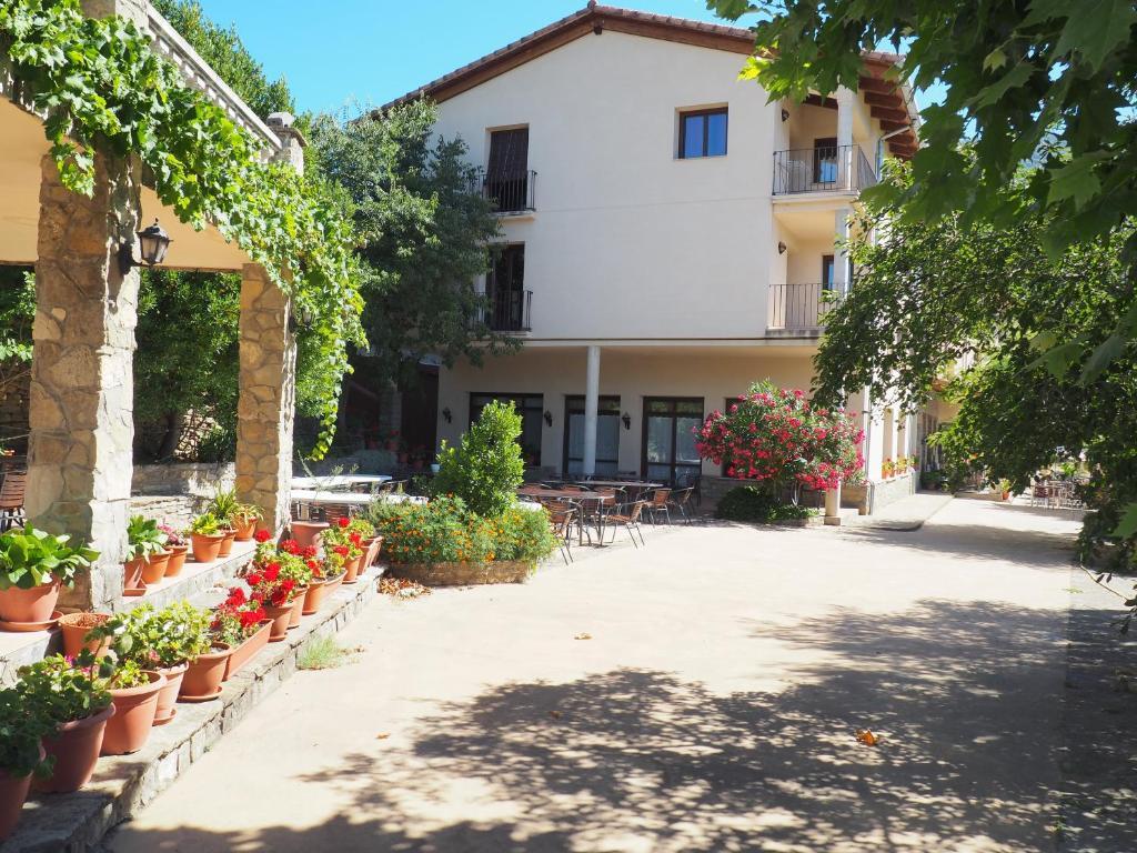 Un patio o zona al aire libre en Hotel Casa Tejedor