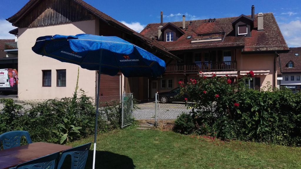 Ein Garten an der Unterkunft Au P'tit Bonheur