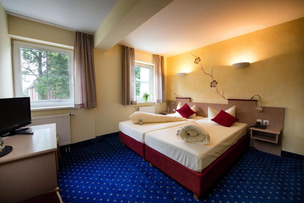 Ein Bett oder Betten in einem Zimmer der Unterkunft Hotel Zum Stern