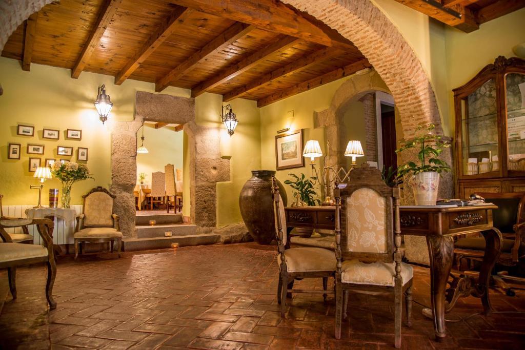 El salón o zona de bar de Hotel Boutique Posada Dos Orillas