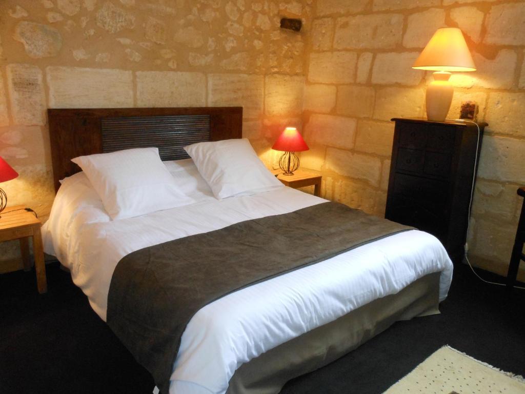 Un ou plusieurs lits dans un hébergement de l'établissement Les Logis du Roy