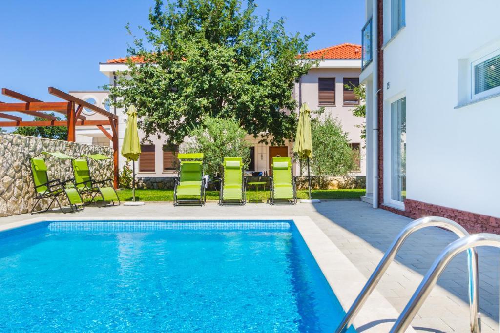 The swimming pool at or near Villa Apartments Futura