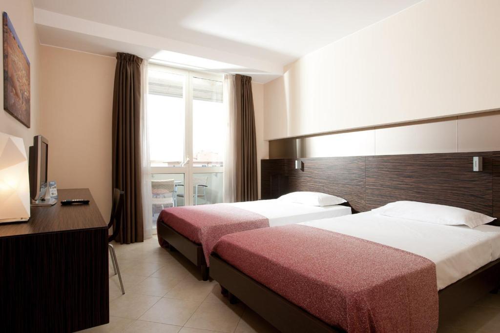 Postel nebo postele na pokoji v ubytování Rosso Frizzante