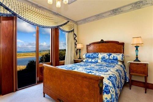 A bed or beds in a room at Apollo Bay Guest House