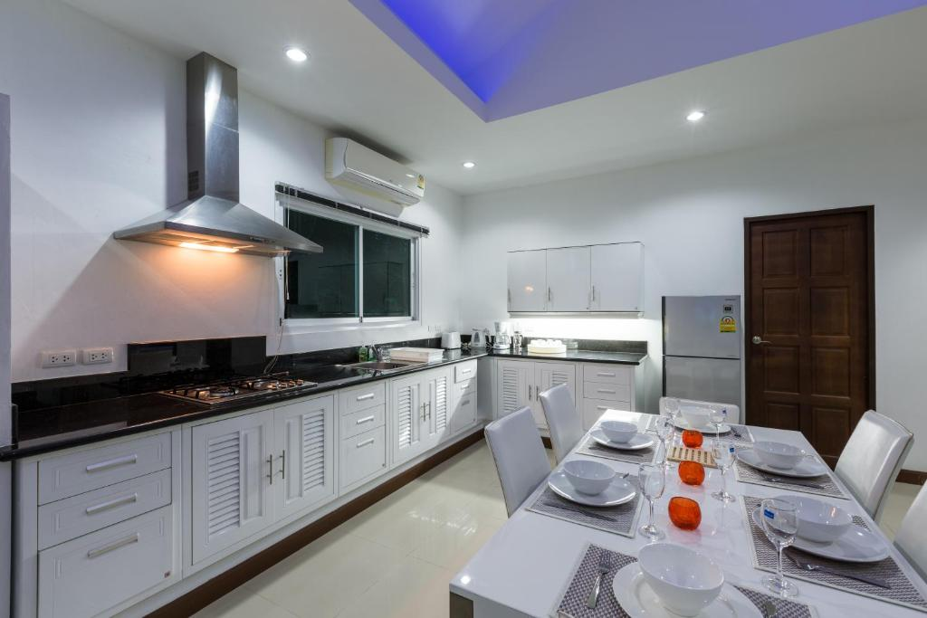A kitchen or kitchenette at Private Pool Villa 4 bedrooms