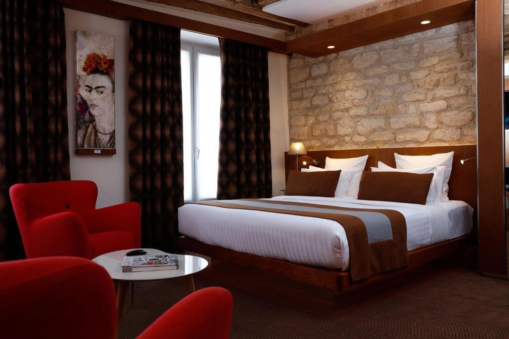 מיטה או מיטות בחדר ב-Select Hotel
