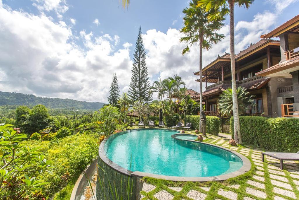 The swimming pool at or near Villa Karma Loka