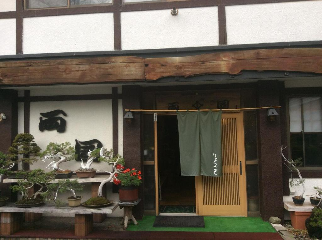 The facade or entrance of Onsen Minsyuku Ryougoku