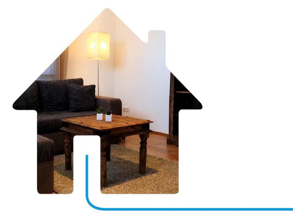 Ein Sitzbereich in der Unterkunft Gästewohnungen Enztal