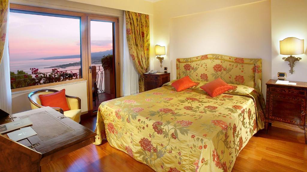 Un ou plusieurs lits dans un hébergement de l'établissement Hotel Villa Diodoro