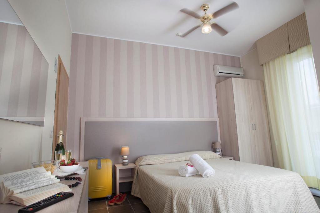 Letto o letti in una camera di Hotel Villa Perazzini