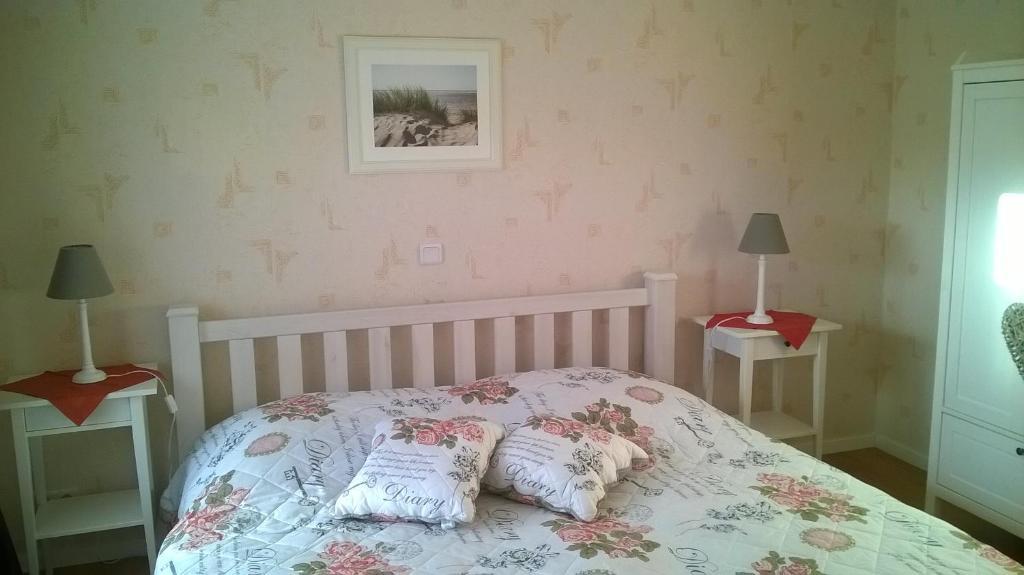 Ein Bett oder Betten in einem Zimmer der Unterkunft Ferienwohnung Nähe Altstadt