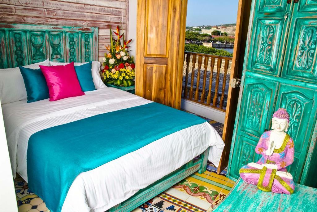 Säng eller sängar i ett rum på Hotel Boutique Casa Isabel