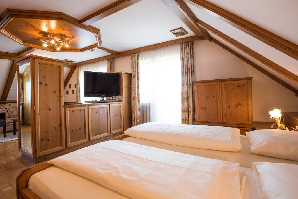 Ein Zimmer in der Unterkunft Meiser Rosenstuben Hotel