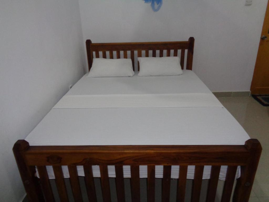 A bed or beds in a room at Sun Guest House