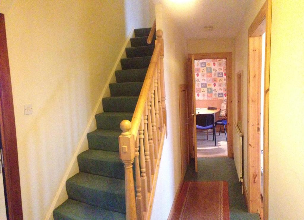 A seating area at House for Groups & Contractors Kilmarnock