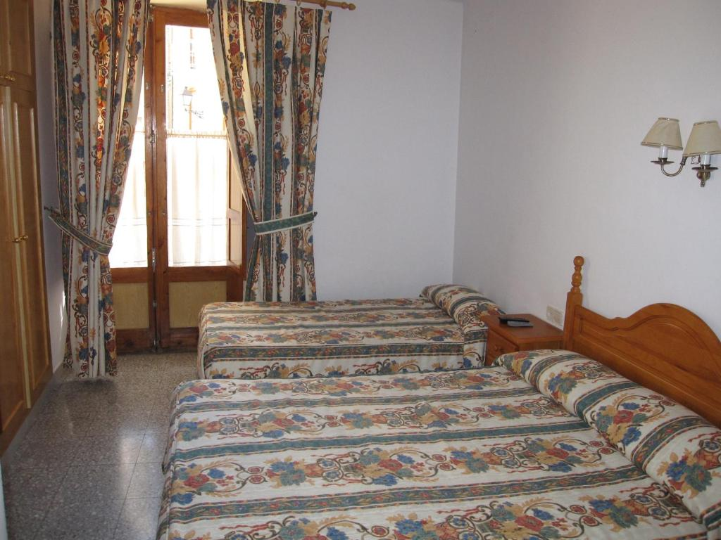 A bed or beds in a room at Fonda Agustí