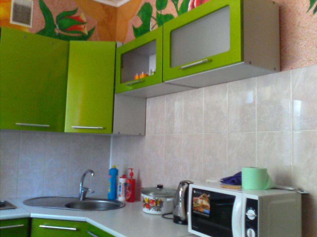 A kitchen or kitchenette at Аmto Mil'kovo