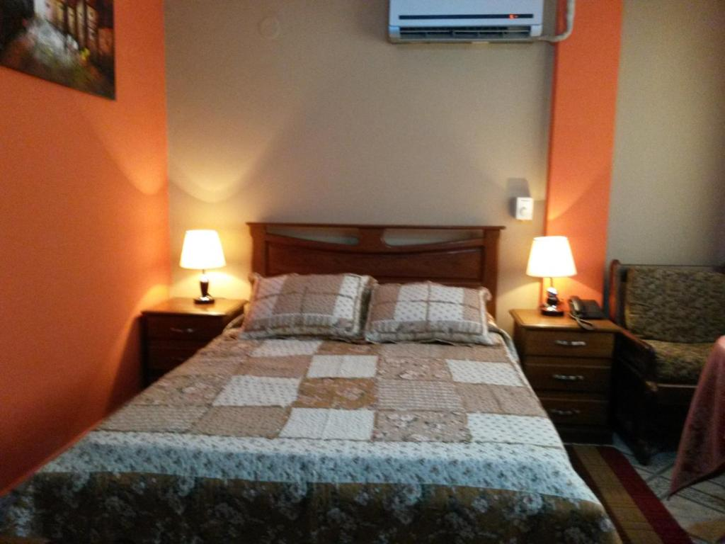 Cama o camas de una habitación en Hotel Piesta