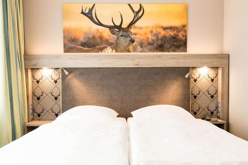 Ein Bett oder Betten in einem Zimmer der Unterkunft Hotel Bavaria Superior